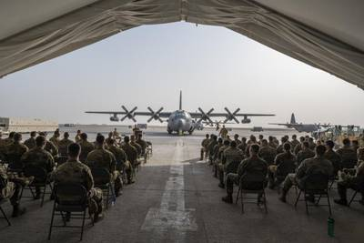 Members of the 380th Air Expeditionary Wing take part in the inactivation ceremony of the 41st Expeditionary Electronic Combat Squadron at Al Dhafra Air Base, United Arab Emirates, Sept. 28, 2021. The 41st EECS operated the EC-130H Compass Call aircraft, conducting electronic warfare for just under 20 years in the U.S. Central Command area of responsibility before being officially inactivated. (Master Sgt. Wolfram Stumpf/Air Force)