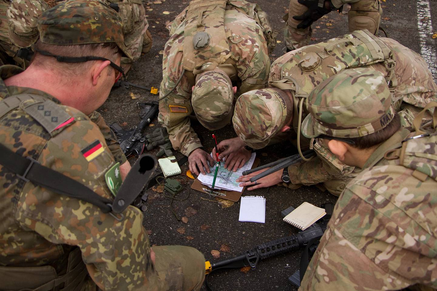 A team of soldiers from 2d Cavalry Regiment and a Panzer Brigade from the German Army plot a point on a map for a land navigation event during a cavalry spur ride Nov. 2, 2017, in the Grafenwoehr Training Area, Germany.
