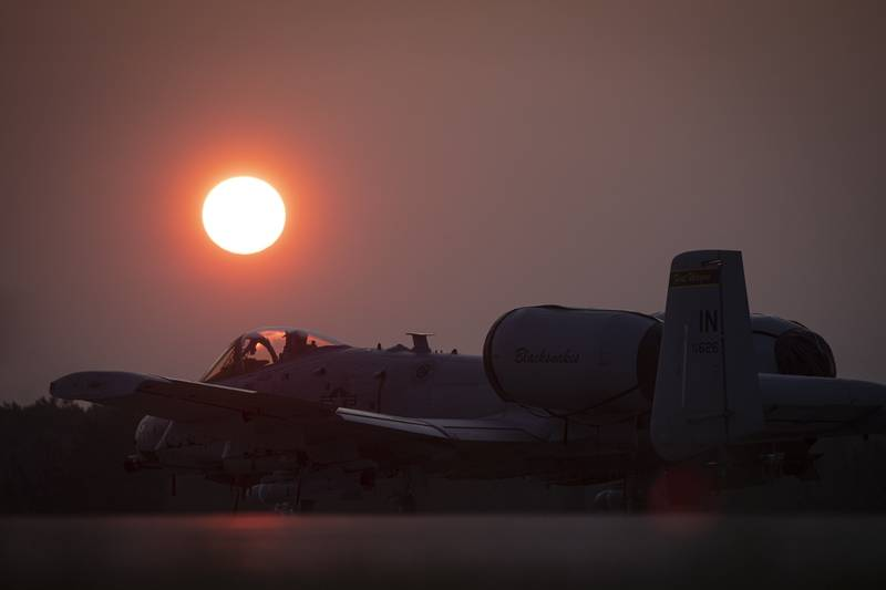 An Air Force A-10C Thunderbolt II sits on the flightline at sunrise during Northern Strike 19 at the Alpena Combat Readiness Training Center, Mich., July 26, 2019.