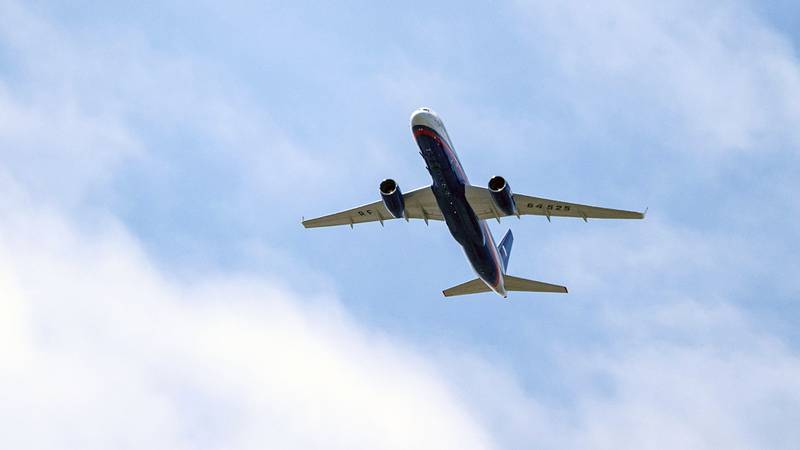 A Russian Air Force Tu-214 flies over Offutt Air Force Base on April 26, 2019, in Omaha, Neb. The flight is allowed as part of the Open Skies Treaty.