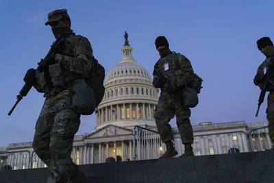 National Guard troops reinforce the security zone on Capitol Hill in Washington, Tuesday, Jan. 19, 2021, before President-elect Joe Biden is sworn in as the 46th president on Wednesday.