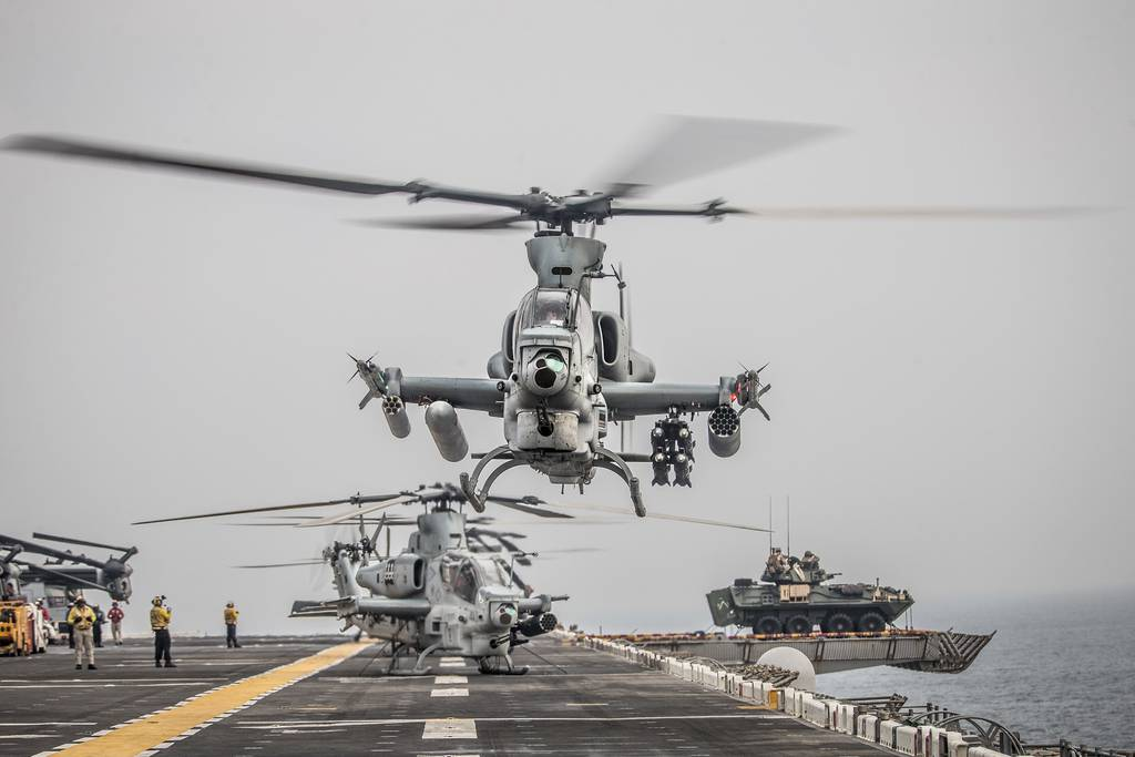 An AH-1Z Viper helicopter takes off Aug. 12, 2019, during a Strait of Hormuz transit aboard the amphibious assault ship USS Boxer (LHD 4).