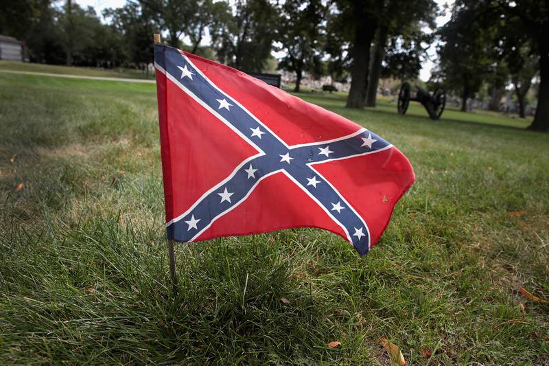A Confederate Navy jack flag sits at the base of Confederate Mound, a memorial to more than 4,000 Confederate prisoners of war who died in captivity at Camp Douglas and are buried around the monument, on Aug. 23, 2017, in Chicago.