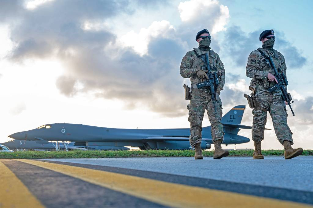 Security forces airmen patrol near a U.S. Air Force B-1B Lancer taxiway at Andersen Air Force Base, Guam, in support of a Bomber Task Force mission, Dec. 26, 2020.
