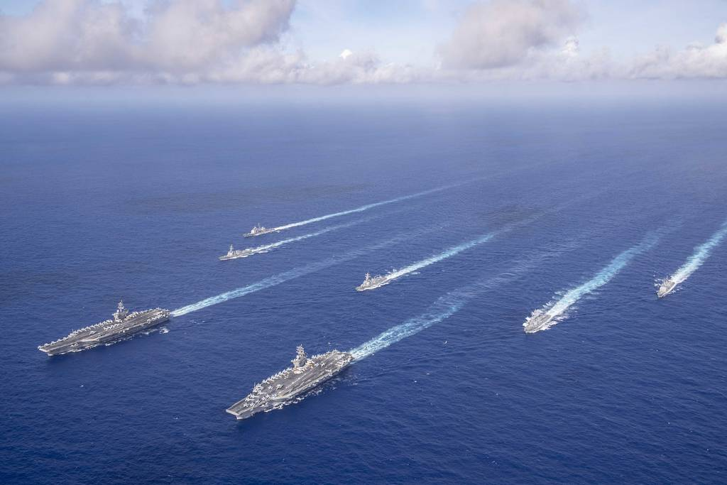 The Theodore Roosevelt and Nimitz carrier strike groups transit the Philippine Sea in formation while conducting dual carrier and airwing operations on June 23, 2020.