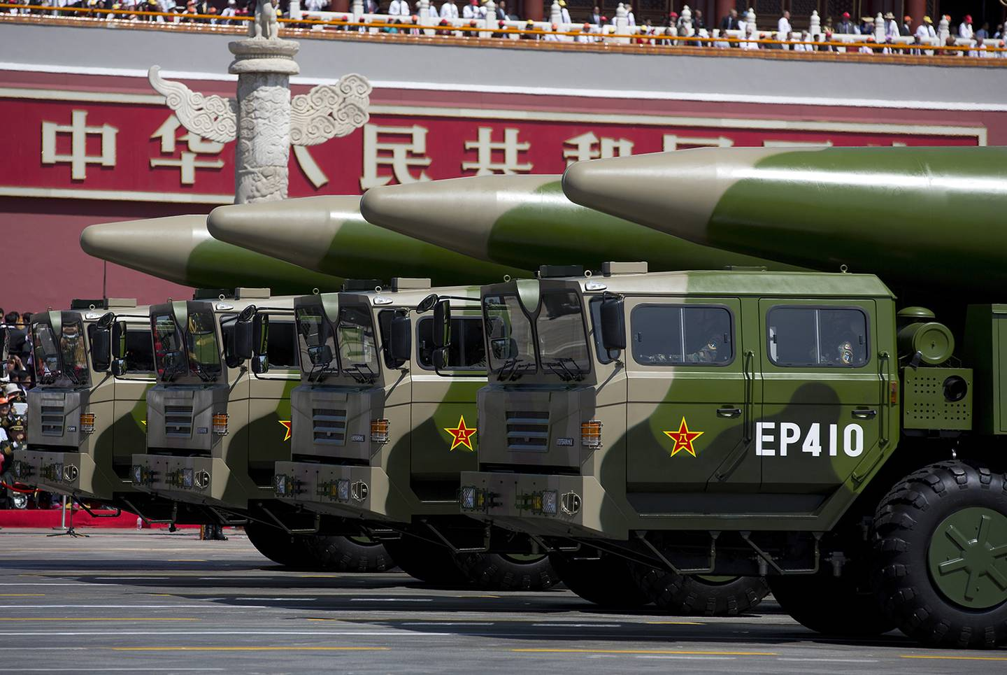 Military vehicles carrying DF-26 ballistic missiles, drive past the Tiananmen Gate during a military parade to mark the 70th anniversary of the end of World War II on Sept. 3, 2015, in Beijing.