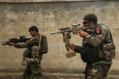 Commandos assigned to 1st Special Operations Kandak clear a training compound during  breaching training in Laghman province, Afghanistan, Feb. 13, 2018.