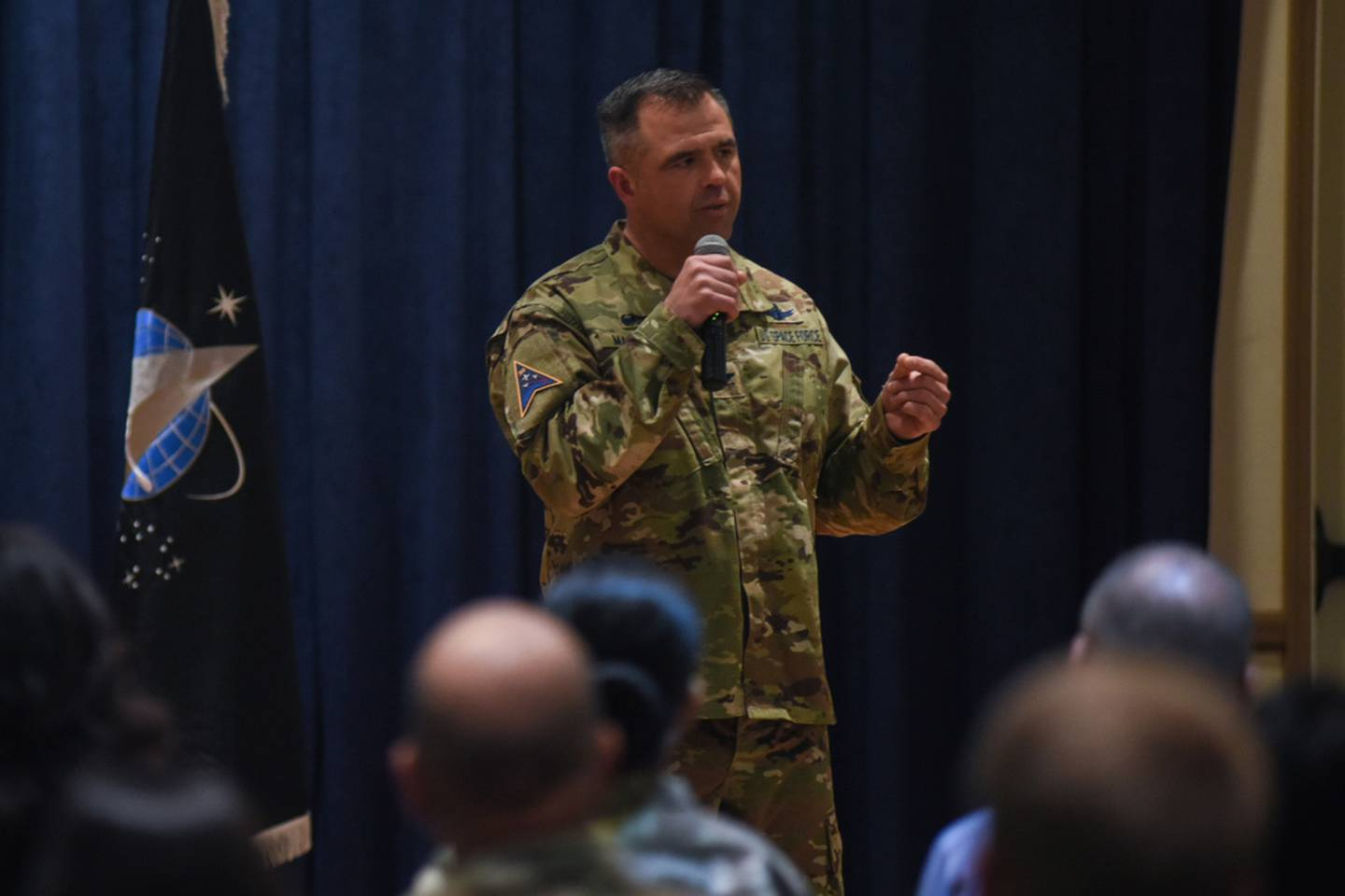 Col. Anthony Mastalir, Space Launch Delta 30 commander, provides information on the U.S. Space Force and changes in the SLD 30 structure during a commander's all call May 25, 2021, at Vandenberg Space Force Base, Calif. (Michael Peterson/Space Force)
