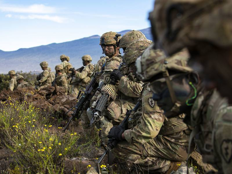 Soldiers with 2nd Squadron, 14th Cavalry Regiment, 2nd Infantry Brigade Combat Team, 25th Infantry Division get ready to bound forward during a fire support coordination exercise Nov. 19, 2019 at Pohakuloa Training Area on the island of Hawaii.