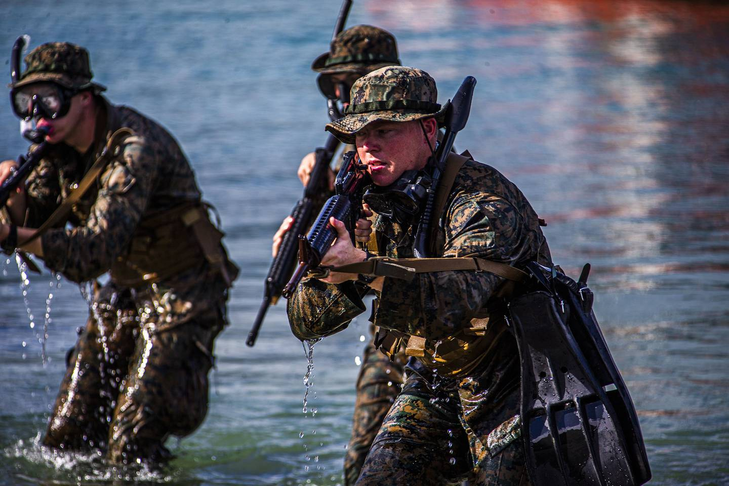 Marines hit the shore during an amphibious assault exercise on Marine Corps Base Hawaii, April 28, 2020.