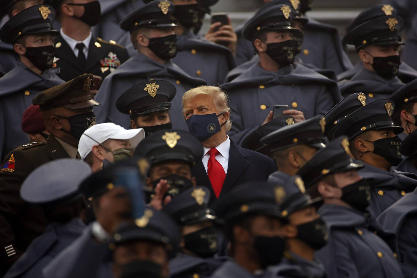 President Donald Trump watches an NCAA college football game with Army cadets during the Army-Navy NCAA college football game on Saturday, Dec. 12, 2020, in West Point, N.Y.