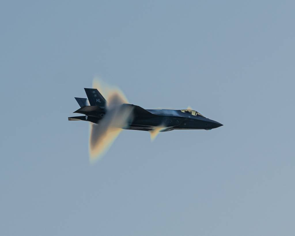 """Air Force Capt. Kristin """"BEO"""" Wolfe, a F-35A Demonstration Team pilot, performs the """"High Speed Pass"""" during the Thunder over Cedar Creek Lake airshow July 4, 2020, Cedar Creek Lake, Texas."""