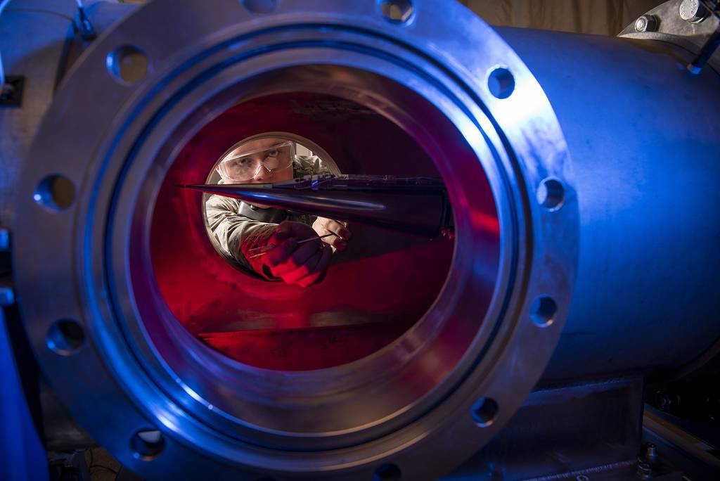 In this Jan. 31, 2019, image provided by the U.S. Air Force Academy, Cadet 2nd Class Eric Hembling uses a Ludwieg Tube to measure the pressures, temperatures, and flow field of various basic geometric and hypersonic research vehicles at Mach 6 in the United States Air Force Academy's Department of Aeronautics, in Colorado Springs, Colo.