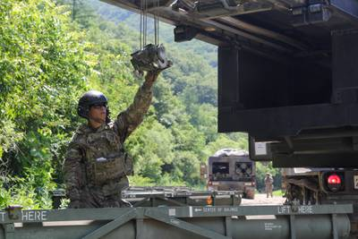 A soldier loads his M270 Multiple Launch Rocket System vehicle during a live-fire training event, June 25, 2019, Republic of Korea.