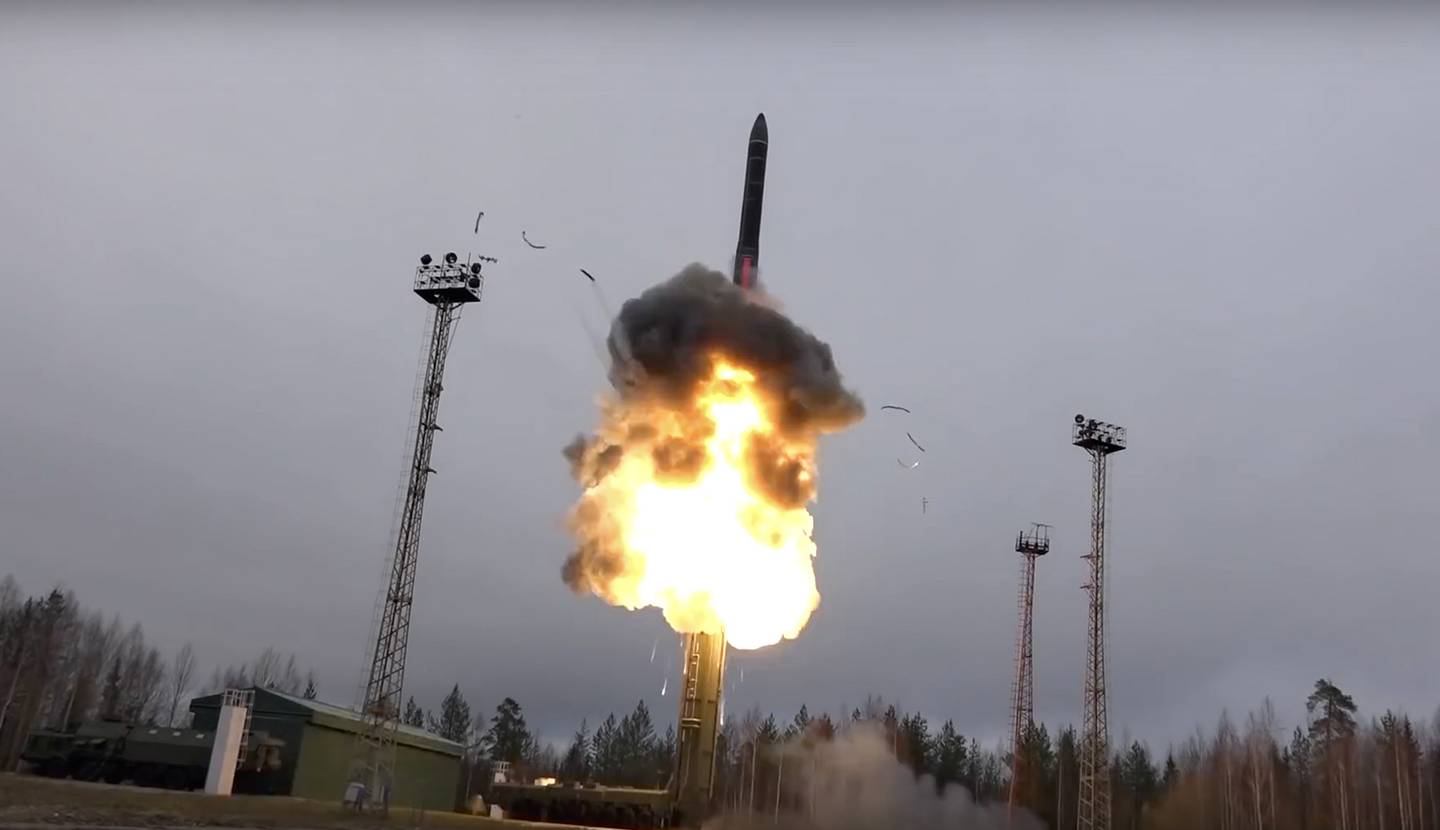 In this photo taken from undated footage distributed by Russian Defense Ministry Press Service, an intercontinental ballistic missile lifts off from a truck-mounted launcher somewhere in Russia.