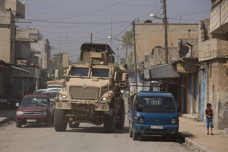 A U.S. armored vehicle drives through Tal Abyad, Syria, on a joint patrol with the Tax Abyad Military Council, an affiliate of the U.S.-backed Syrian Democratic Forces Friday, Sept. 6, 2019.