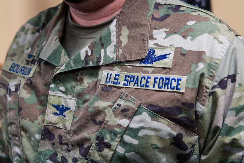 Col. Richard Bourquin, Space Delta 4 commander, poses for a detailed photo of his new U.S. Space Force patches after commissioning into the USSF in the DEL 4 conference room on Buckley Air Force Base, Colo., Jan. 5, 2021. (Airman 1st Class Joshua T. Crossman/Space Force)