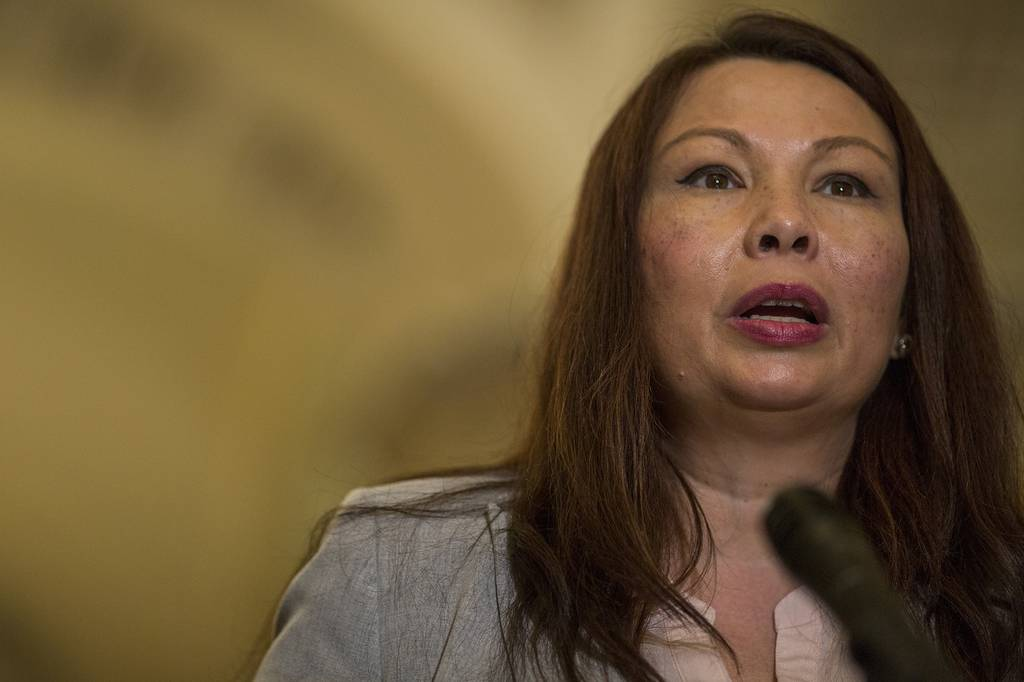 Sen. Tammy Duckworth, D-Ill., speaks during a weekly news conference on Capitol Hill  on Aug. 21, 2018, in Washington.