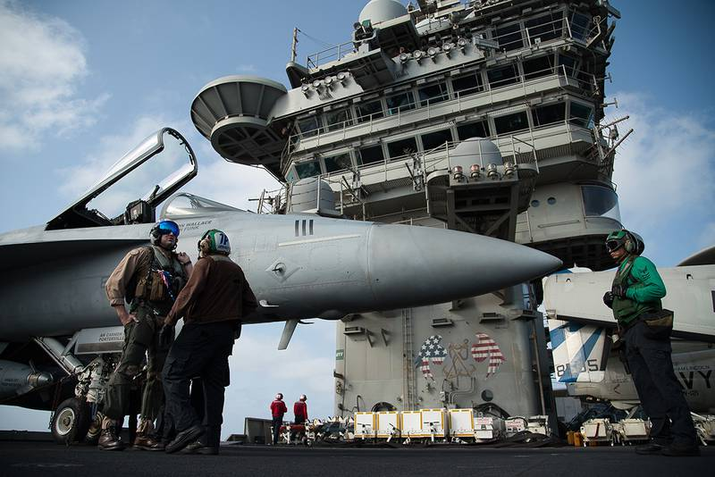 F/A-18 fighter jet on the deck of the USS Abraham Lincoln