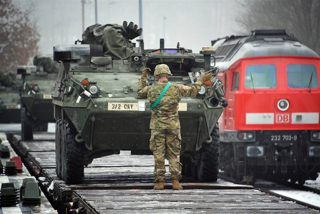 U.S. soldiers assigned to Lightning Troop, 3rd Squadron, 2nd Cavalry Regiment, load Stryker Fighting Vehicles on rail cars at Rose Barracks' railhead station in Vilseck, Germany, in 2016.