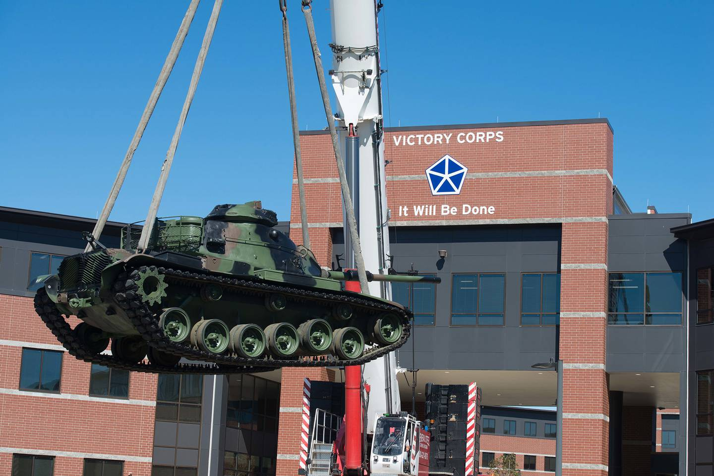 A tanks is lowered to its new home in front of the V Corps headquarters at Fort Knox, Ky., Oct. 14, 2020.