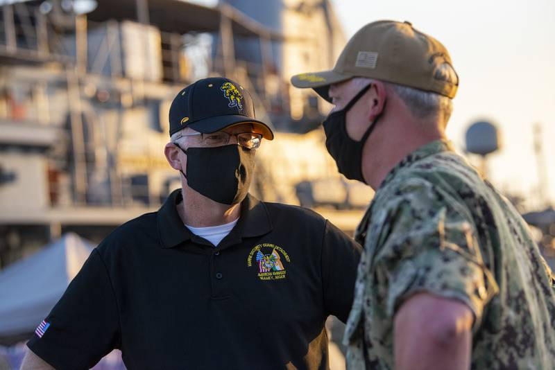 Acting Defense Secretary Christopher C. Miller meets with Navy Capt. Christopher Gilbertson, the commander of Task Force 55, during a visit to Naval Support Activity, Bahrain, Nov. 25, 2020.