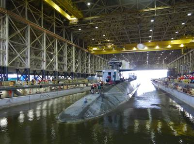 The Ohio-class ballistic-missile submarine USS Tennessee (SSBN 734) enters the Trident Refit Facility, Kings Bay, Ga., dry dock Feb. 1, 2021, for an extended refit period.