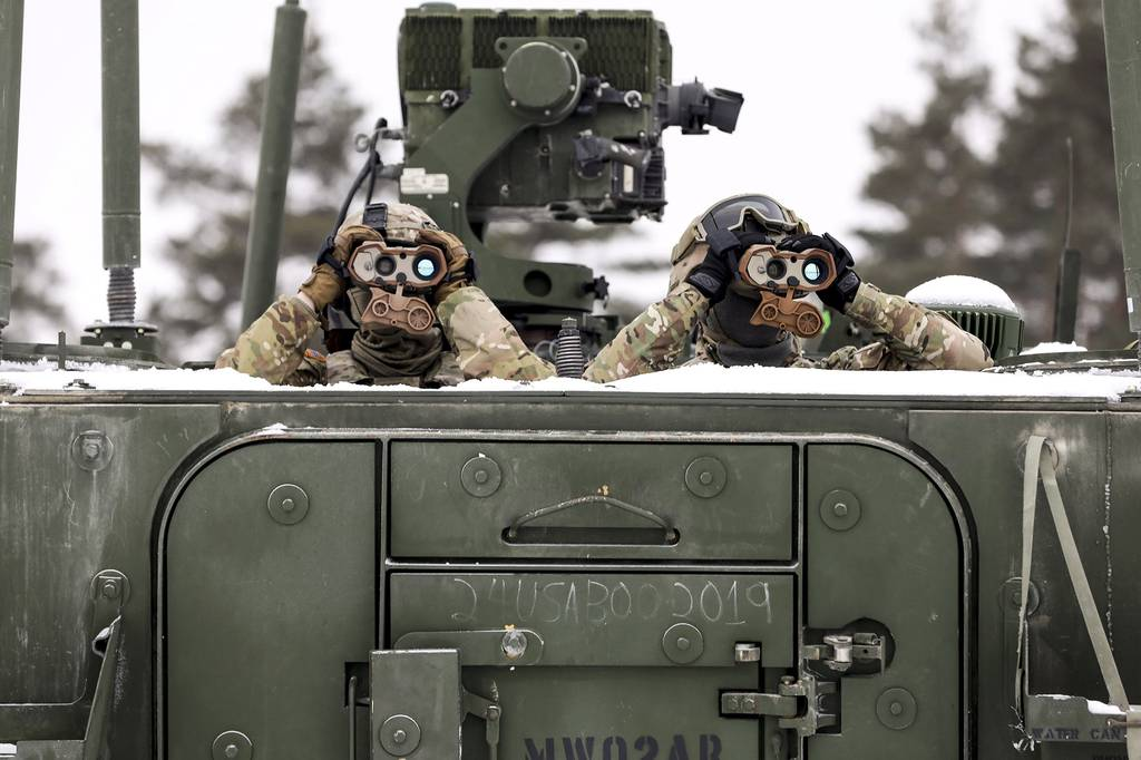 Soldiers from 1st Squadron, 2d Cavalry Regiment, enhanced Forward Presence Battle Group Poland, keep watch on targets  during a joint combat live fire of the Gepard Air Defense System Feb. 2, 2021, at Bemowo Piskie Training Area, Poland.