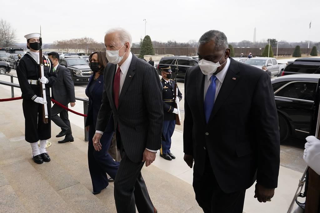 President Joe Biden and Vice President Kamala Harris walk with Secretary of Defense Lloyd Austin at the Pentagon, Wednesday, Feb. 10, 2021, in Washington.