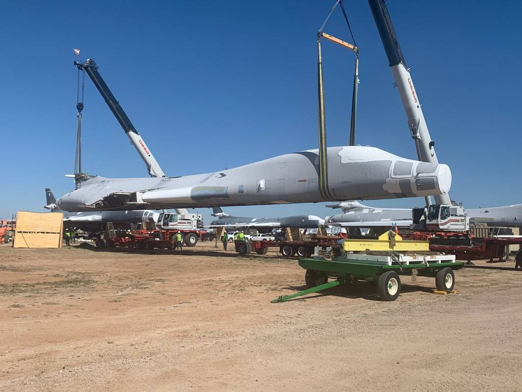 B-1B Lancer tail number 85-0092 is lifted and placed on flatbed trailers for the 1,000-mile journey to Wichita, Kan., April 24, 2020. The National Institute for Aviation Research at Wichita State University will scan every part of the aircraft to create a digital twin that can be used for research. (U.S. Air Force photo by Daryl Mayer)