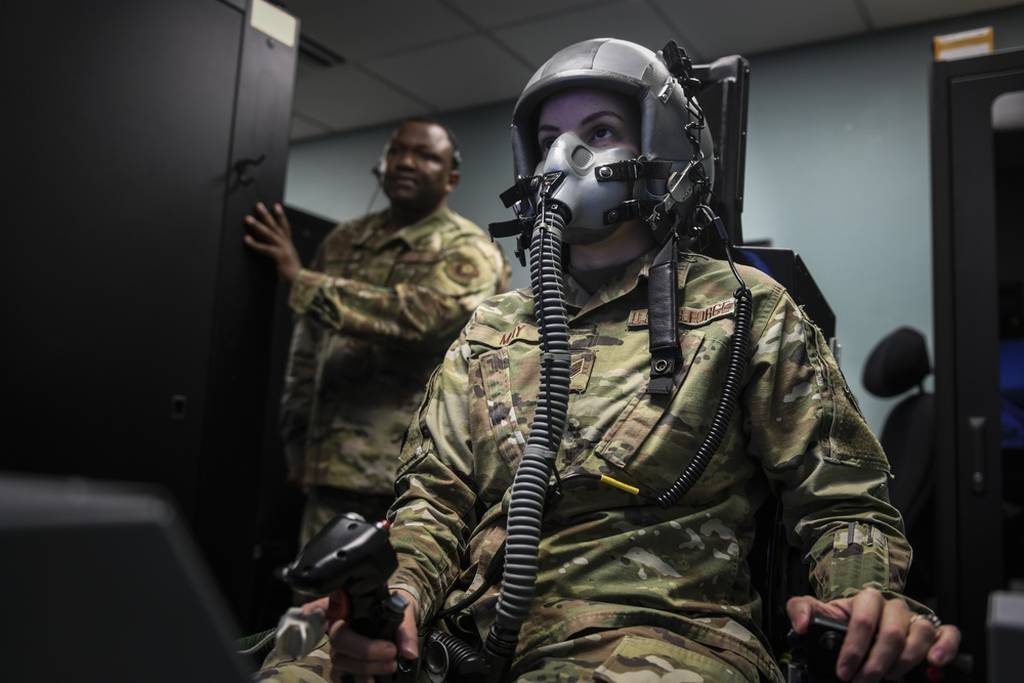 Staff Sgt. Kimberly May, noncommissioned officer in charge of aerospace and operations physiology for the 1st Special Operations Support Squadron, operates a hypoxia-familiarization trainer at Hurlburt Field, Florida, July 11, 2019. May and her team of five train aircrew by using a reduced oxygen breathing device (ROBD) to detect the signs of hypoxia during flight. Hypoxia is a condition caused by a lack of oxygen that can lead to injury to personnel, damage to Air Force assets and death. (Senior Airman Dennis Spain/Air Force)