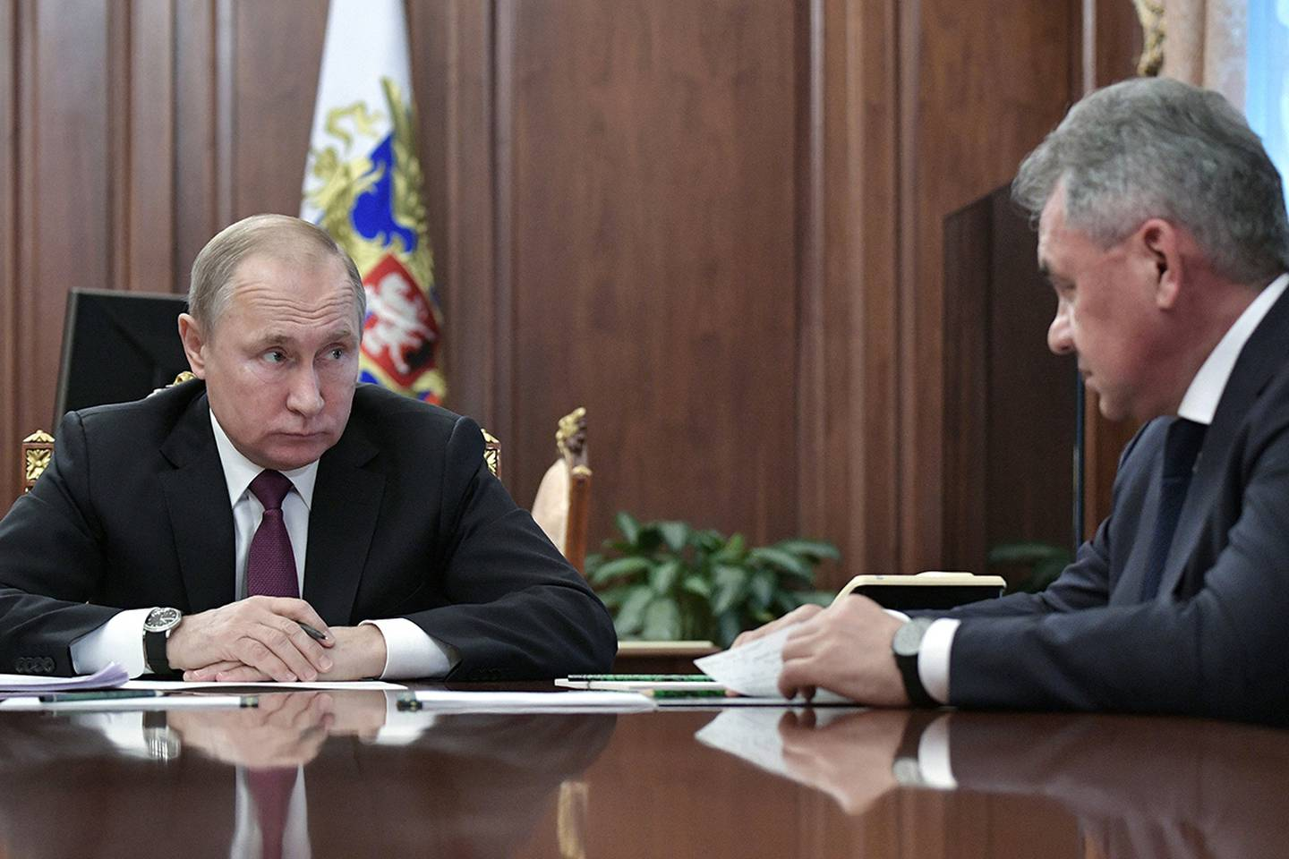 In this Feb. 2, 2019, file photo, Russian President Vladimir Putin, left, speaks to Defense Minister Sergei Shoigu during a meeting in the Kremlin in Moscow.