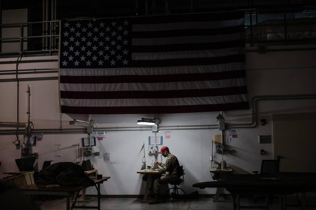 U.S. Army parachute riggers sew face mask prototypes at Aviano Air Base, Italy.