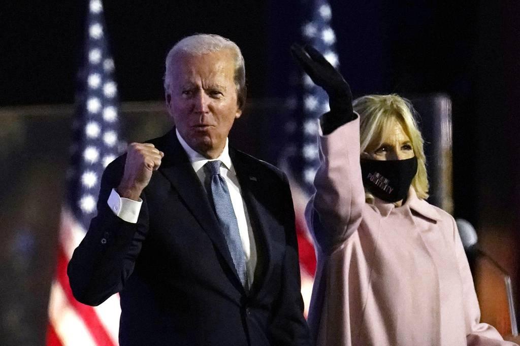 Democratic presidential candidate former Vice President Joe Biden arrives to speak to supporters, early Wednesday, Nov. 4, 2020, in Wilmington, Del., as Jill Biden looks on.