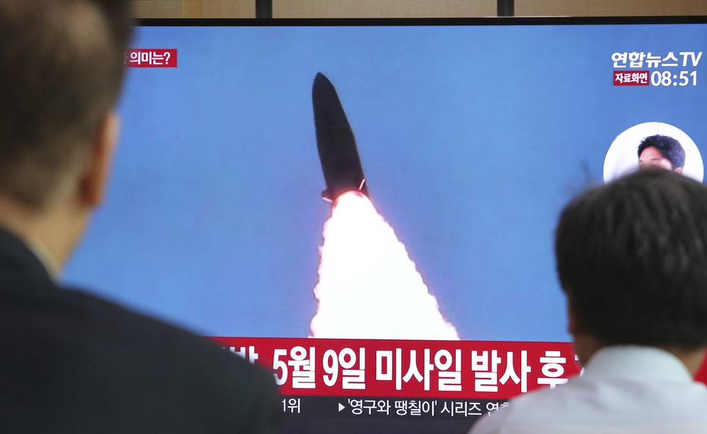 People watch a TV showing a file image of North Korea's missile launch during a news program at the Seoul Railway Station in Seoul, South Korea, Thursday, July 25, 2019.