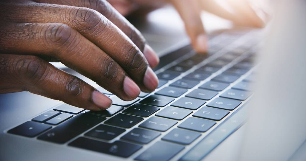 Person typing on a laptop