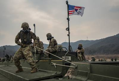 U.S. Army soldiers maneuver and connect a section of an Improved Ribbon Bridge during a rafting exercise on Namhan River, South Korea.