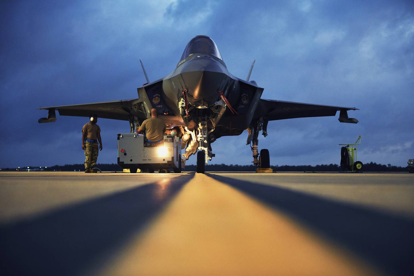 U.S. Air Force weapons load crew members load an AIM-120 advanced medium-range air-to-air missile on an F-35 Lightning II during Exercise Combat Archer at Eglin Air Force Base, Fla., June 10, 2020