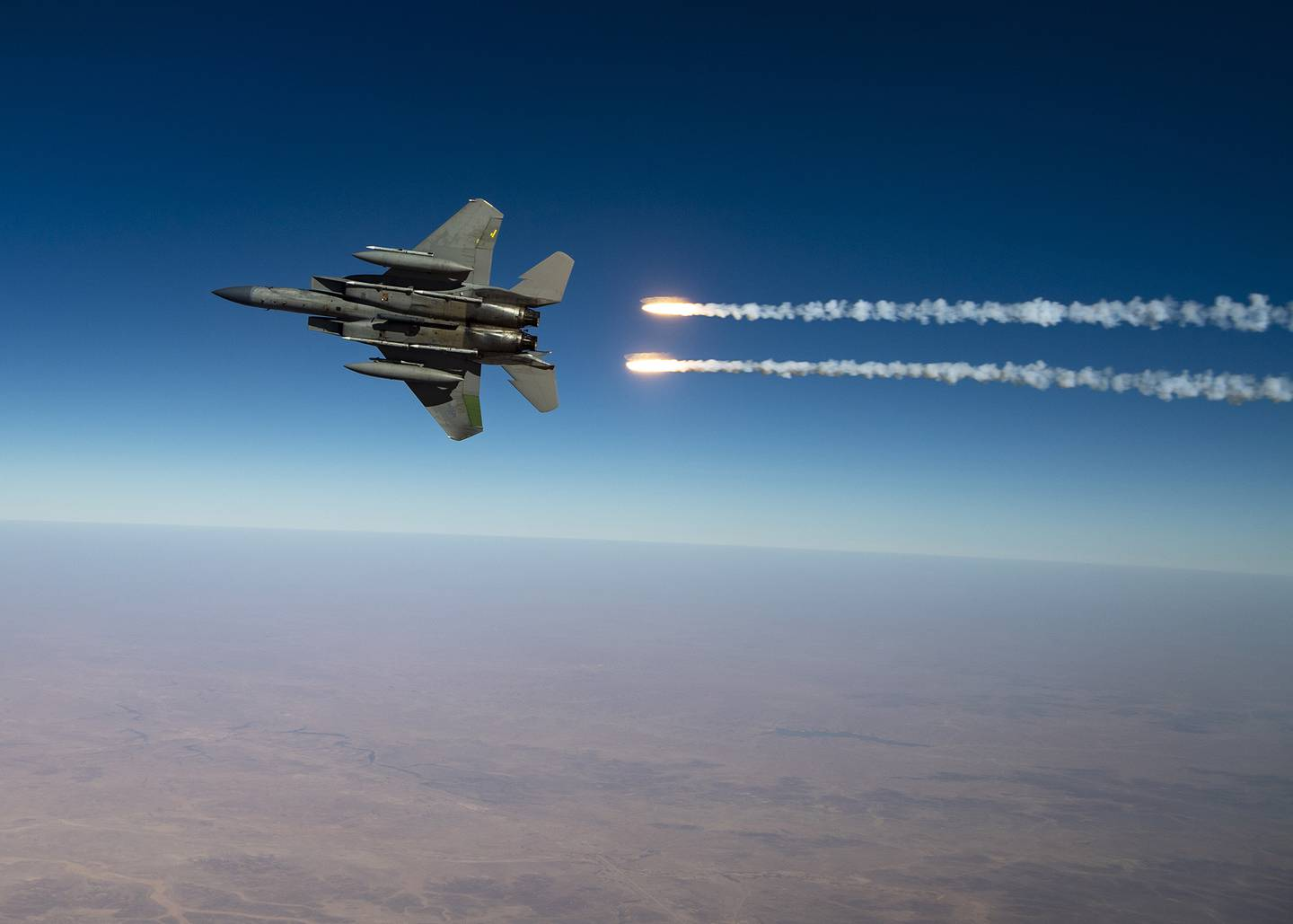 A U.S. Air Force F-15C Eagles release flares over the U.S. Central Command area of responsibility Aug. 13, 2020