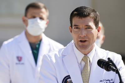 Dr. Sean Conley, physician to President Donald Trump, briefs reporters at Walter Reed National Military Medical Center in Bethesda, Md., Sunday, Oct. 4, 2020.