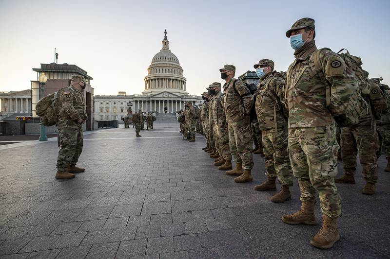 New Jersey National Guard soldiers and airmen from 1st Battalion, 114th Infantry Regiment, 508th Military Police Company, 108th Wing, and 177th Fighter Wing arrive near the Capitol to set up security positions in Washington on Jan. 12, 2021.