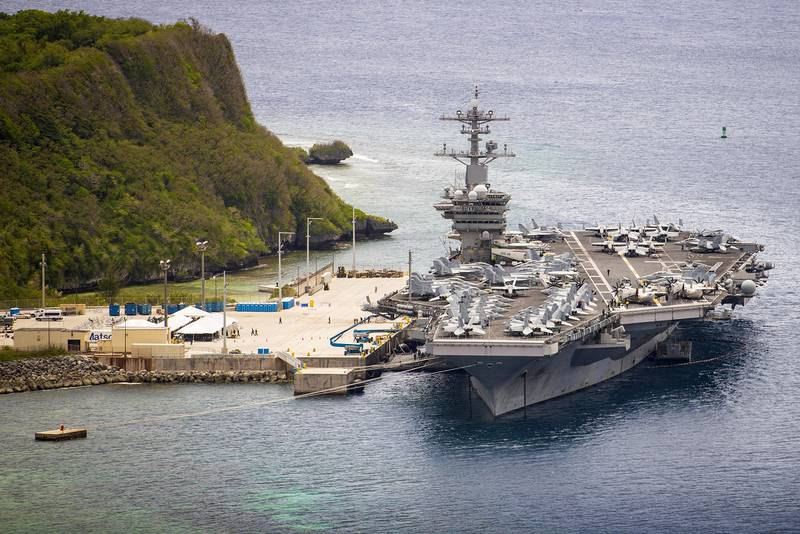 The aircraft carrier USS Theodore Roosevelt (CVN 71) is moored pier side at Naval Base Guam May 15, 2020.