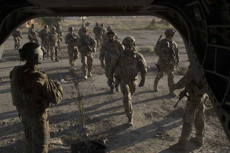 American and Afghan National Army soldiers board a CH-47 Chinook helicopter following a key leader engagement Dec. 2, 2019, with senior Afghan government officials to discuss ongoing security efforts in southeastern Afghanistan.