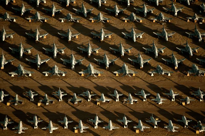 """Rows of F-4 Phantoms and T-38 Talons line the grounds of the 309th Aerospace Maintenance and Regeneration Group, also known as the  """"Boneyard,"""" at Davis-Monthan Air Force Base, Ariz."""